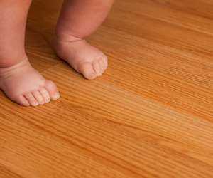 Baby Walking on Hardwood Floor