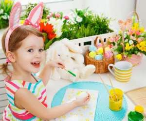 Litle Girl Wearing Bunny Ears Painting Easter Eggs