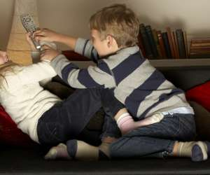 siblings fighting over the remote