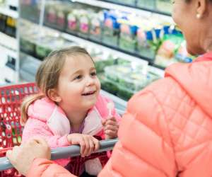 mom teaching daughter diversity lesson at target