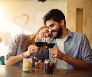 couple on valentines day saying cheers with wine