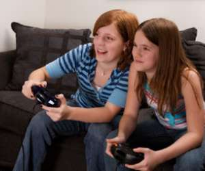 Tween girls playing video games