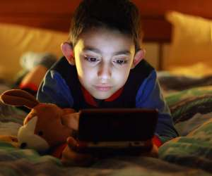 boy playing video game alone