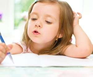 girl learning to write