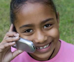 Young girl using flip phone